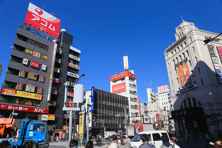 ASAKUSA, TOKYO, JAPAN - NOVEMBER 19, 2014:  Road in front of the entrance of Asakusa Temple, Is a hub transit point and shopping one of the most famous attractions