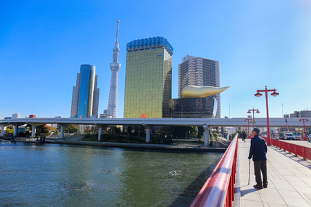 ASAKUSA, TOKYO, JAPAN - NOVEMBER 19, 2014:  Asahi beer tower and Tokyo skytree is landmark in asakusa city, Is a place famous and popular for tourist with Sumida river.