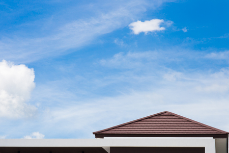 Roof of modern house with blue sky background. Copy space background Stock Photo