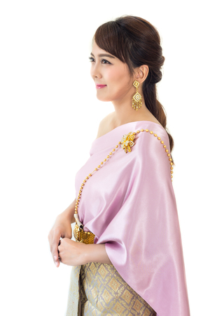 Women stand wearing traditional cloth Thailand or Thai dress isolate on white background