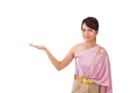 Women stand wearing traditional cloth Thailand or Thai dress welcome isolate on white background. Copy space