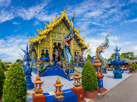 Wat Rong Sua Ten temple with blue sky background, Chiang Rai Province, Thailand, It's a popular destination and Landmark of Chiang Rai Stok Fotoğraf