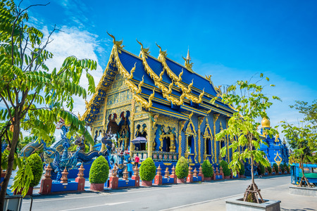 Wat Rong Sua Ten temple with blue sky background, Chiang Rai Province, Thailand, It's a popular destination and Landmark of Chiang Rai 免版税图像