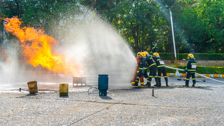 Fire drill training or fireman presentation in outdoor. 免版税图像