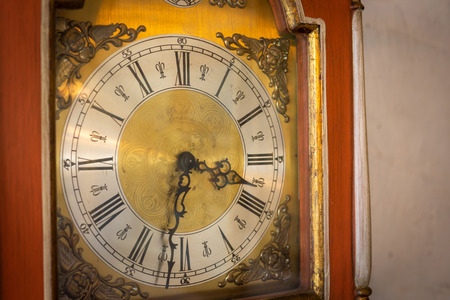Old vintage or classic clock face with wood frame on wall. Copy space background. Reklamní fotografie