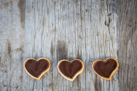 Chocolate heart on wooden background for gift in Valentines day love. Select focus and Copy space background