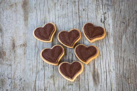 Chocolate heart on wooden background for gift in Valentines day love. Select focus