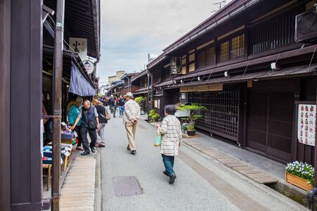 Takayama, Japan - May 9, 2015: Tourists visit the old town in Takayama. Is a famous and popular place and is a conservation place since the Edo period 報道画像