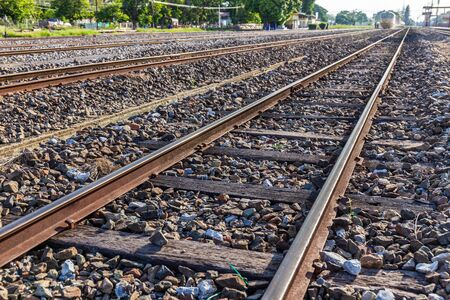 Old train or railroad tracks with wooden backing In the countryside Thailand