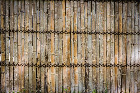 Bamboo wall texture background with The rope is tied together in a row.