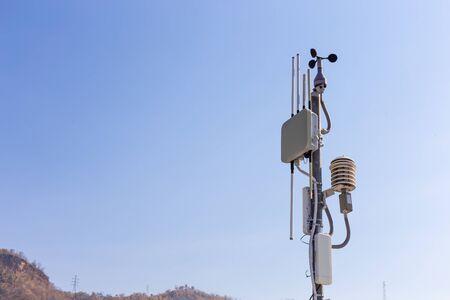 Communication towers and weather monitoring equipment at Srinakarin Dam, Kanchanaburi Province, Thailand