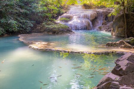 Landscape of Erawan waterfall in national park Is a waterfall in the deep forest with antimony fish at Kanchanaburi, Thailand.