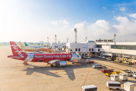 Bangkok, Thailand - November 11,2016 : The plane of Air Asia that is parked on Don Mueang Airport is waiting to transport people by weaving both domestically internationally.