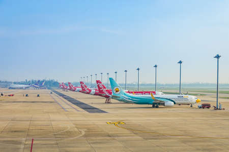 Bangkok, Thailand - November 11,2016 : The plane of Air Asia, Nok Air  and Thai airway that is parked on Don Mueang Airport is waiting to transport people by weaving both domestically internationally. Sajtókép