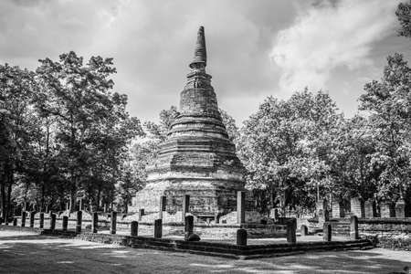 Landmark of old chedi made of ancient bricks in the Kamphaeng Phet Historical Park, Thailand. Black and white