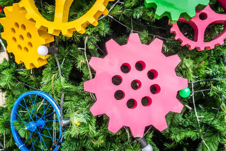 Full-color gears decorated on the Christmas tree symbolize the new year transformation concept. Copy space background Imagens