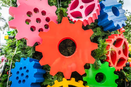 Full-color gears decorated on the Christmas tree symbolize the new year transformation concept. Copy space background