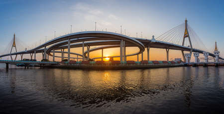 Panorama landscape of Bhumibol Bridge is a large and modern-looking bridge that is an important landmark of Bangkok in sunset time Imagens