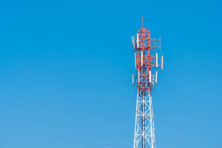 Telephone tower with blue sky background. Copy space