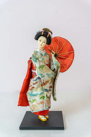 Japanese kimono doll or Hina Ningyo in a red kimono on a white background Banque d'images