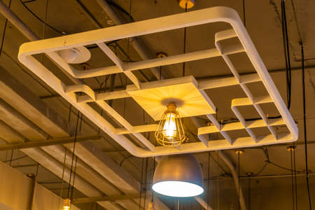 Antique lamps decorate the interior of the building, giving off a warm yellow glow.