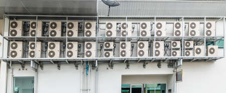 Many air conditioners units compressor are attached to the sides of large buildings for cooling.