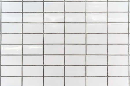 The white tiles on the walls are arranged in an orderly fashion.
