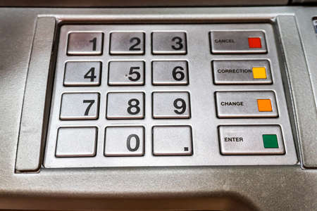 Closeup of Modern Silver Metal ATM Keypad. Select focus