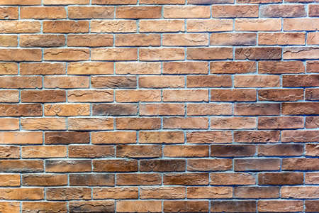 Brown brick walls lined up in the background.