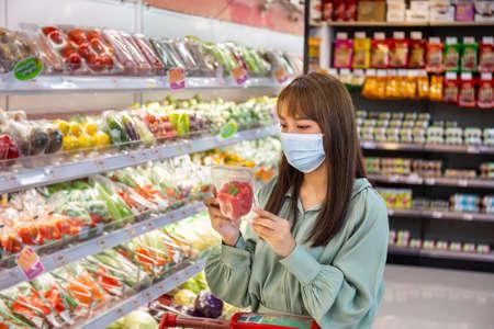 Women wear masks to shop vegetable bell pepper in supermarkets