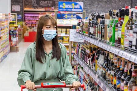 Women wear masks to shop in supermarkets, new normal lifestyles