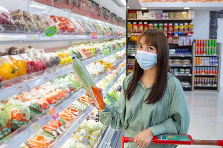 Women wear masks to shop vegetable in supermarkets, new normal lifestyles