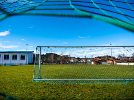 Soccer field with net in the countryside Stock Photo