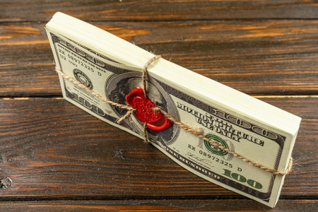 Prop Money Dollars.Full Print Old Style.100 Dollar Bills. Sealed brick with sealing wax and rope.