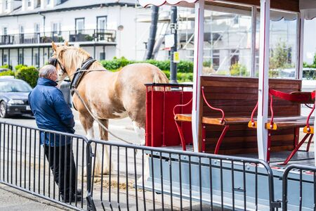Douglas, Isle of Man, June 16, 2019. The Douglas Bay Horse Tramway on the Isle of Man runs along the seafront promenade Editorial