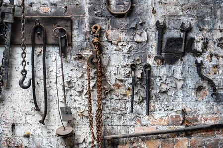 Mechanical workshop at old abandoned factory. Old rusty tools