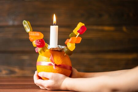 Orange Christingle is a symbolic object used in the Advent, Christmas and Epiphany services of many Christian denominations Zdjęcie Seryjne