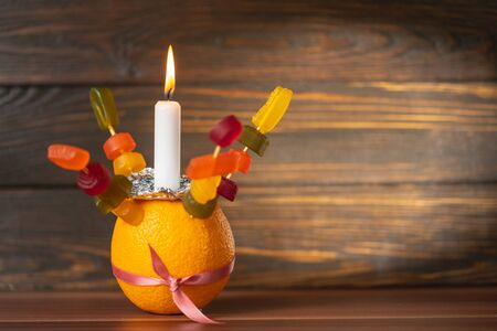 Orange Christingle is a symbolic object used in the Advent, Christmas and Epiphany services of many Christian denominations 写真素材