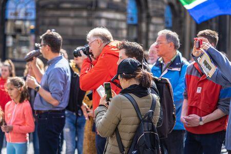 Edinburgh, Scotland, August 8th 2019. Photographer or Blogger shooting photos or video, using modern simple set of equipment