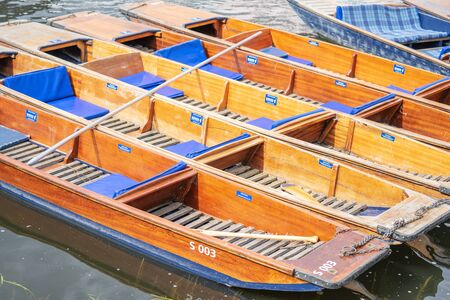 A punt is a flat-bottomed boat with a square-cut bow, designed for use in small rivers or other shallow water. Cambridge, England