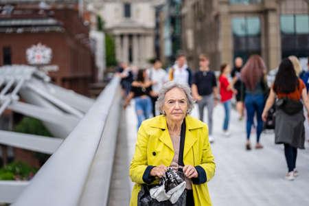 London, UK, July 14, 2019. Elderly Woman walking by the millennium bridge