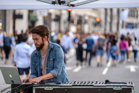 London, UK, July, 2019. DJ playing at Summer Streets event, Regent Street