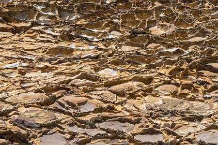 Geological rock layers.Close-up abstract shot of the rock face Reklamní fotografie