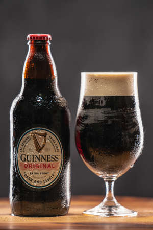 Guinness is a dark Irish dry stout that originated in the brewery of Arthur Guinness at St. Jamess Gate Dublin Ireland, in 1759. UK, Bedford, December 27, 2020