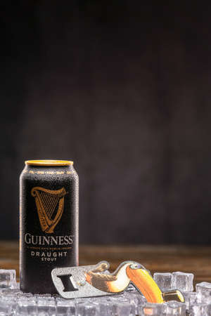 Guinness Draught Can on ice and Guinness Toucan Bottle Opener. UK,Bedford,January 4,2021 新闻类图片