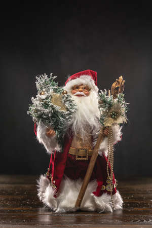 Santa Claus doll toy standing on a wooden table