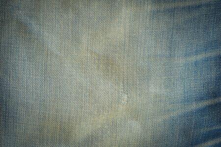 vestige: Old Denim Jeans Background with small tear, Vintage Stock Photo