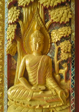 public domain: Golden Sculpture High-relief buddha on gate to sanctuary in temple, Public domain