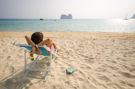 panoramic beach: Girl sitting on a beach chair