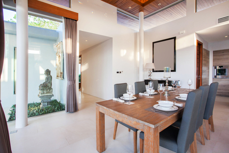 high ceiling: Luxury interior design in living room of pool villas. Airy and bright space with high raised ceiling and wooden dining table